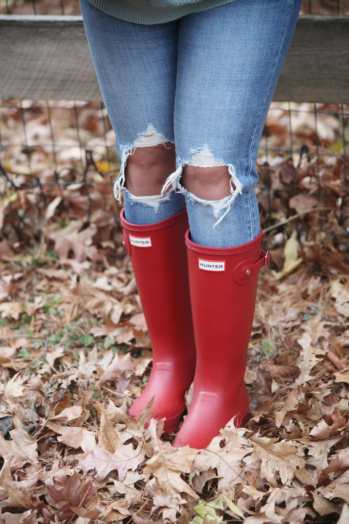 Blue Jeans and Red Hunter Boots!Blue jeans, soft sweaters, and red Hunter Boots. Check out how fashion, lifestyle, and beauty blogger Little Tree Vintage styles this cozy outfit for Fall and Winter.