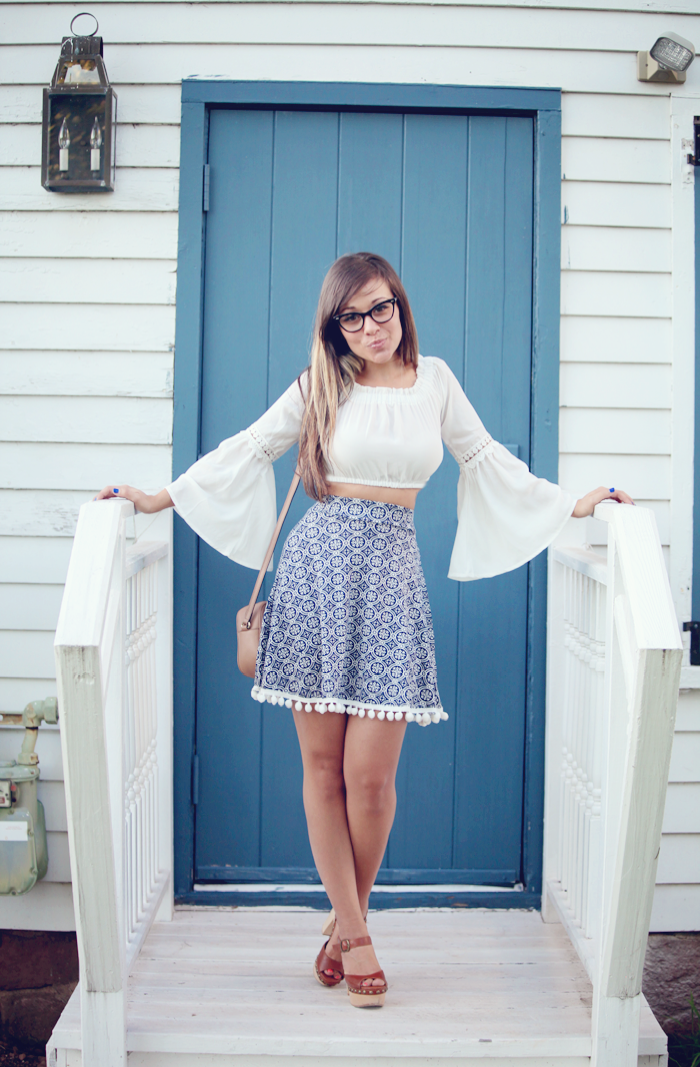 See how to style a high waisted skirt and bell sleeve top from fashion blogger, Little Tree Vintage!