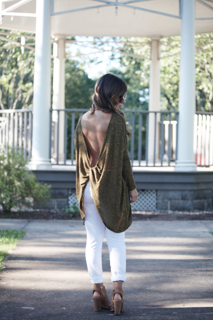 Save this! This fashion blogger shows us how to easily transition from Summer to fall with white denim and a cutout back comfy sweater.